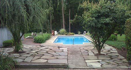 A flagstone patio replaces a lawn to extend the outdoor living area for this Boyertown, Pa family