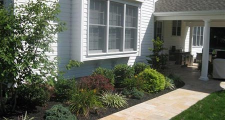 walkway and foundation plantings leading to Phoenixville, Pa patio designed by Whitehouse Landscaping