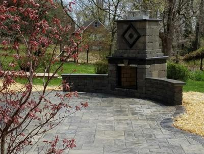 A fireplace and patio in Phoenixville, PA designed and installed by Whitehouse Landscaping.