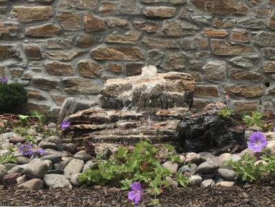 Bubbling fountain installed in Schwenksville backyard.
