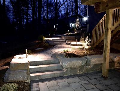 Steps and walkway become a wonderful focal point as well as a functional feature to the property.