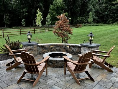 Wonderful outdoor living space with patio, sitting wall and fire pit.