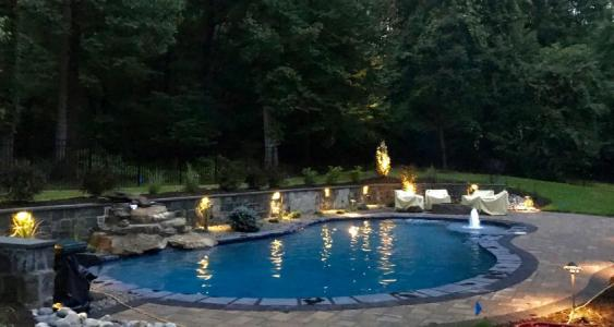 Outdoor lighting surrounding pool in Glenmoore.