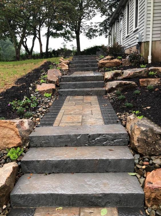These Rocka Steps by Techo-Bloc were incorporated into this incline which serve both a practical and aesthetic purpose.