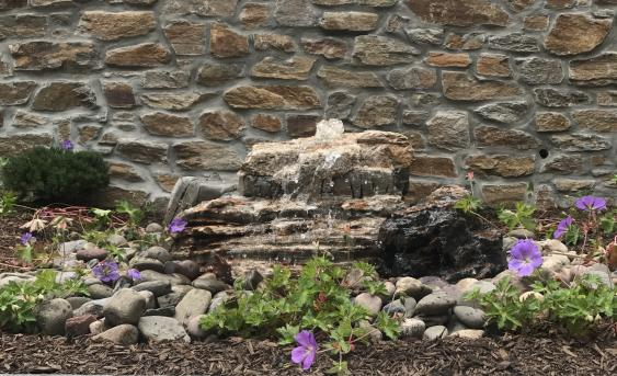 Bubbling fountain installed in Schwenksville backyard.