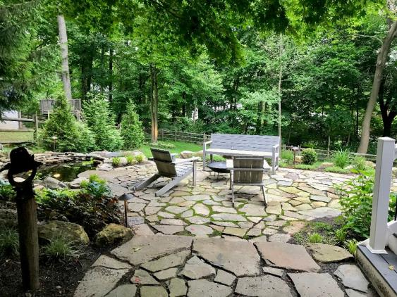 An example of a free form patio installed in Wayne, PA using Mountain Fieldstone