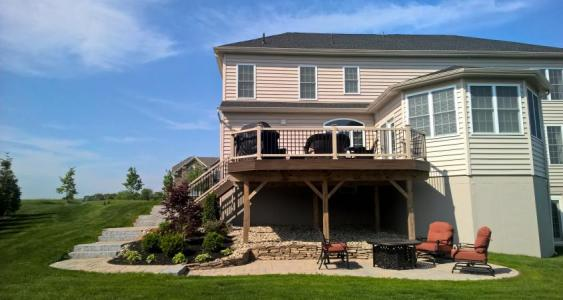 Deck and patio installation in Collegeville give multiple areas for seating.