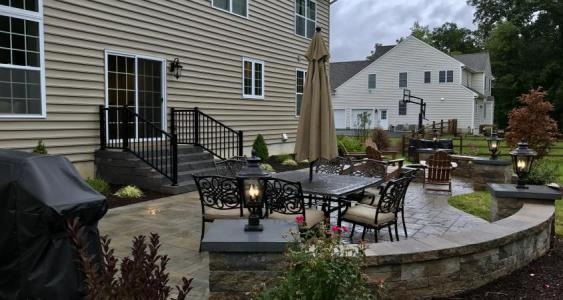 This wall adds visual interest and extra seating to our client's Downingtown patio.