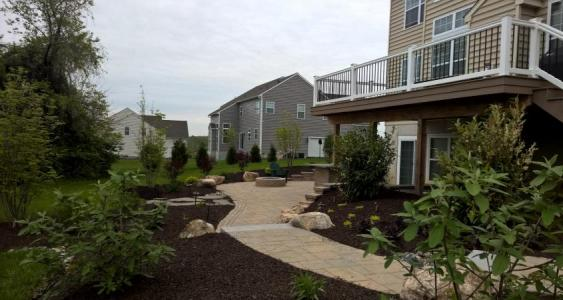Newly planted shrubs will give this Downingtown patio lots of privacy.