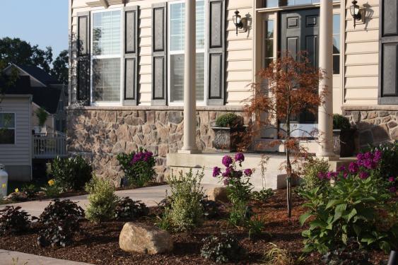 A renovated landscape bed in Harleysville improves curb appeal.