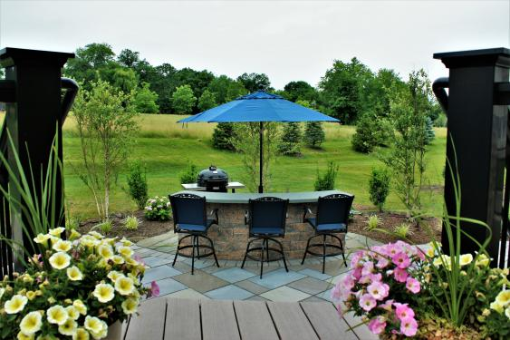 Hardscaping in Phoenixville include patio and island for eating.