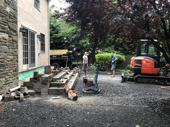 Tearing out the old deck and the anticipation of the new patio.