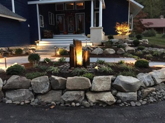 Hardscaping includes the use of natural stone.  Front entrance in Spring City, PA