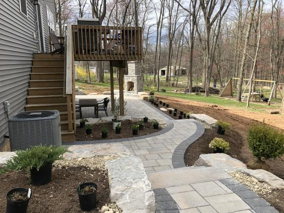 The addition of a patio made this a true family outdoor living space.