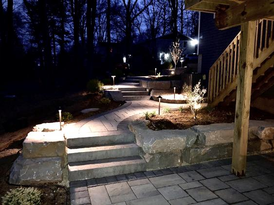 A walkway,  steps and lighting in East Coventry, Pottstown that accommodates a sloped yard.