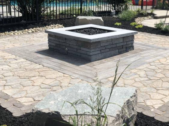 This Techo-Bloc Prescott propane fire pit in Schwenksville will become the life of the patio party for this family.   The unique selection of pavers sets this project apart.