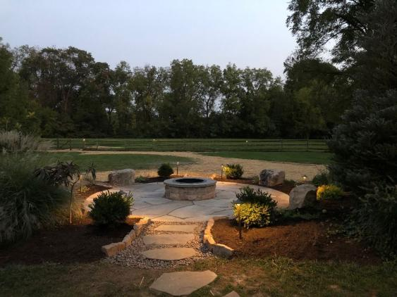 A fire pit with lighting extends your outdoor living even as the temperatures drop.