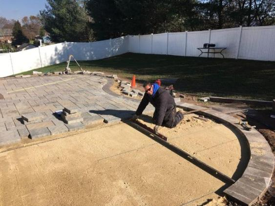 Mark leveling sand for new patio in Gilbertsville, PA