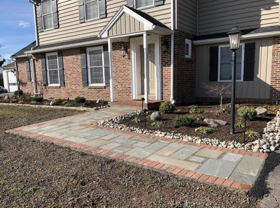 Natural cleft pattern flagstone with brick border recently installed.