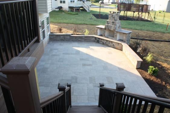 This large rectangular patio features Kennedy Blue Mountain pavers, a great sitting wall and a fireplace.