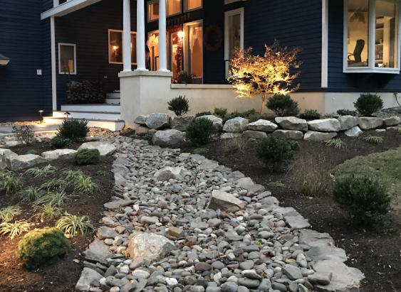River rock and boulders enhance this Spring City, PA entrance.