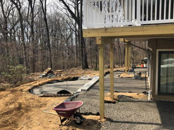 Current installation in Wayne of a patio with a deck above.