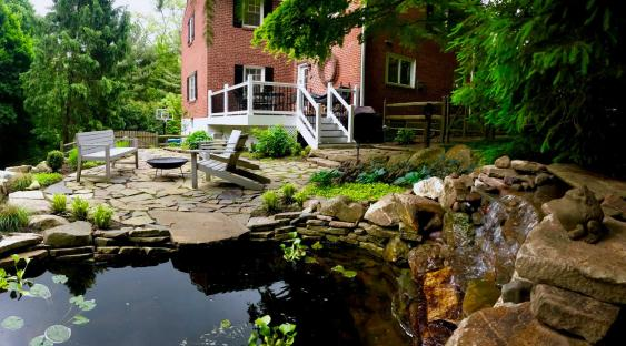 Pond and waterfall create a peaceful oasis for flagstone patio in Wayne.