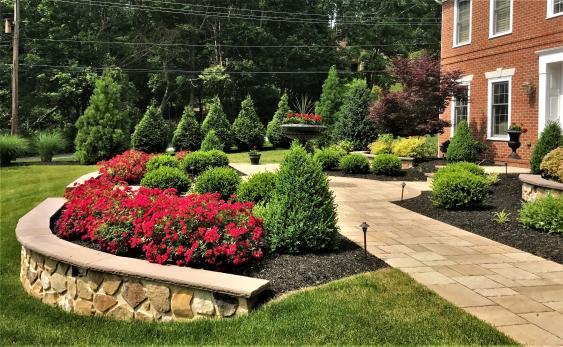 Retaining wall created a level space while holding back the planting area.  The wall created a great focal point in the landscape.