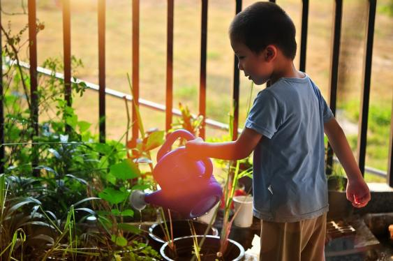 Gardening with children gets them outdoors.