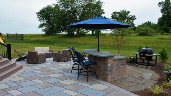 Patio space in Phoenixville accommodates room for conversation and a bar. area.