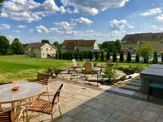 This multi level patio in Schwenksville creates two different outdoor living areas but totally accessible to one another.