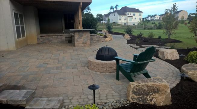 extended under the deck patio with fire pit and natural boulders in downingtown pa - Patio Under Deck