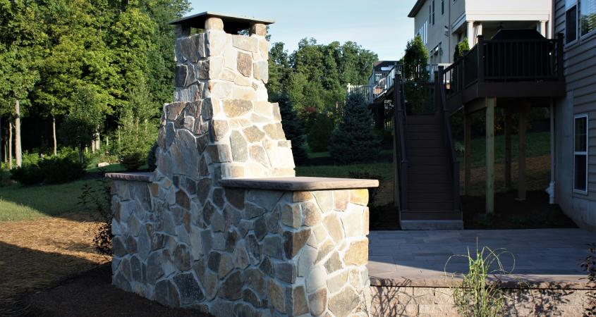 Backview stone veneer outdoor fireplace in Skippack, PA