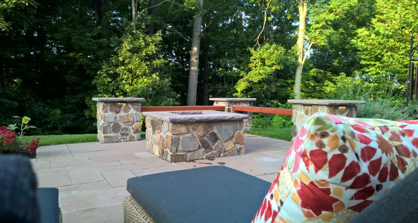 Fire pit in Pottstown, PA with chaise lounge and pillow