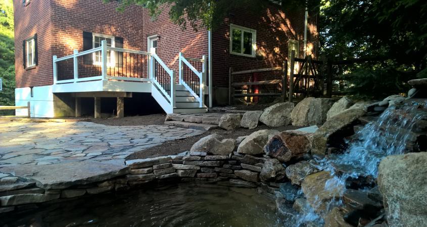 Backyard pond and waterfall in Wayne, PA with flagstone patio pavers