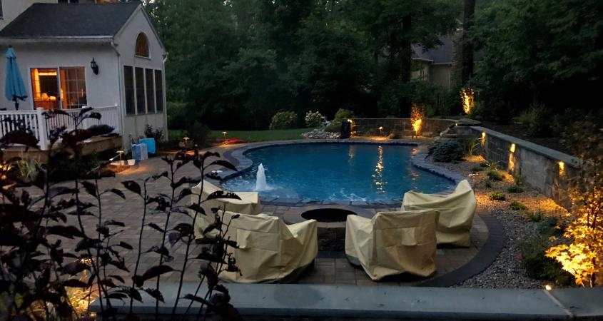 Outdoor lighting, firepit and inground pool in Glenmoore, PA