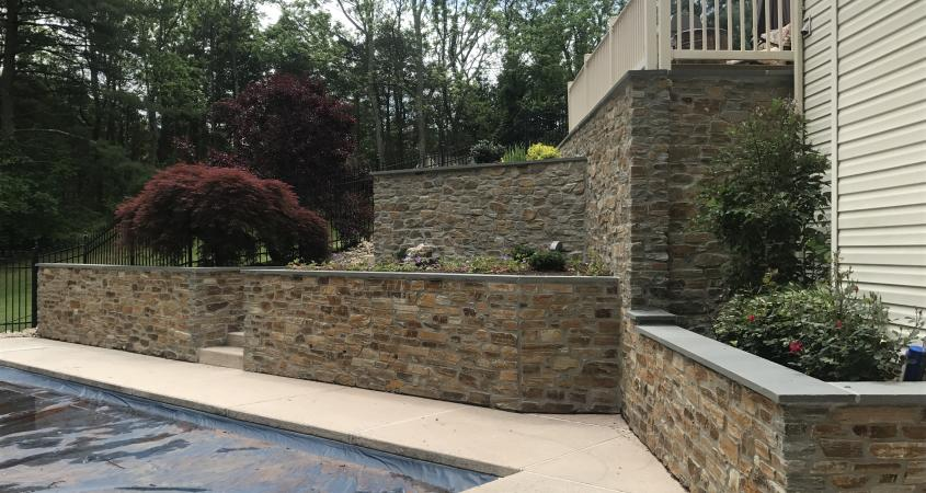 Multi level retaining wall with stone veneer in Schwenksville, PA