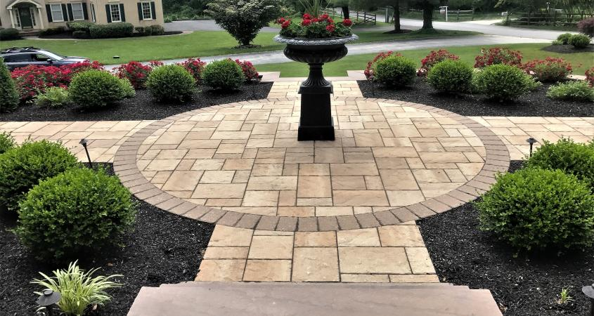 Circular walkway in Malvern, PA with planter and shrubs