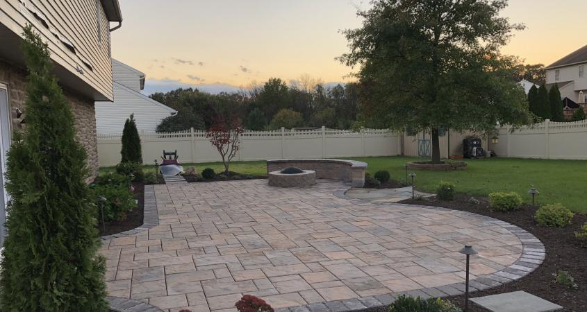 Douglassville paver patio with fire pit and sitting wall