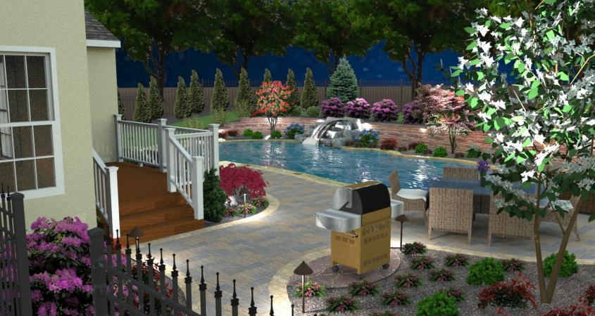 Pool design with natural stone grill area and landscape lighting.