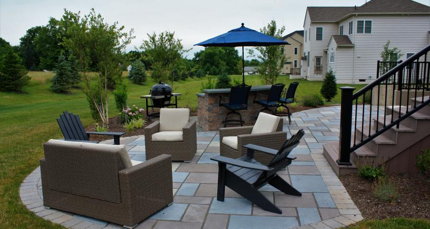 Patio in Phoenixville, PA with chairs, steps and stone bar
