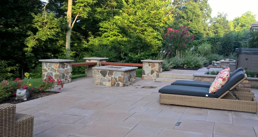 Patio in Pottstown, PA with reclining chairs and stone benches
