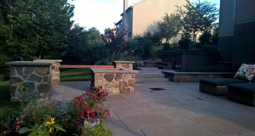 Patio in Pottstown, PA with fire pit, stone bench and chairs