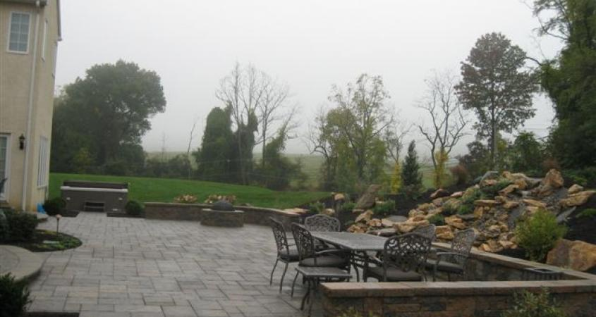 This sitting wall enclosing this patio in Malvern, Pa is attractive and offers additional seating.