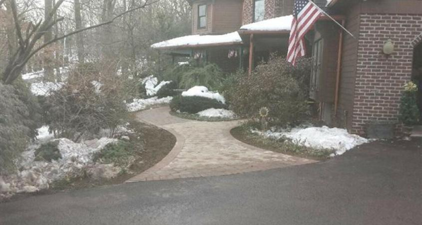 An inviting front paver walkway with a flaired entrance dramatically increases this Reading, Pa. home's curb appeal.