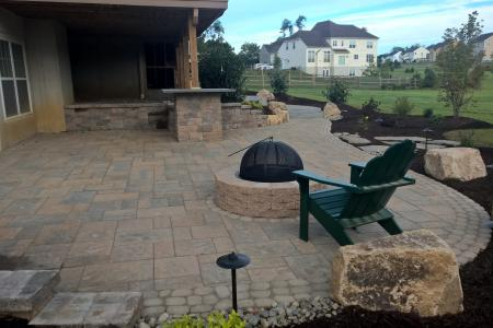 Backyard fire pit in Downingtown, PA with chair and patio pavers
