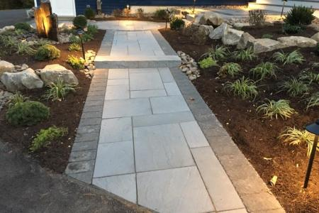 Walkway in Spring City, PA with shrubs and lights