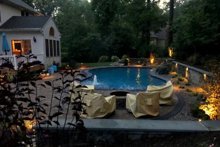 Fire pit in Glenmoore, PA with inground pool and lights