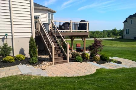 Walkway in Phoenixville, PA with back deck and shrubs
