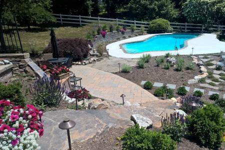 Landscaping with pool, walkway and shrubs in Hatfield, PA